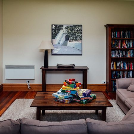 Family room with TV, entertainment set, games & books