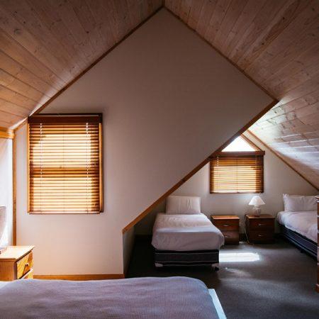 Bedroom 3 (upstairs) 1 queen, 2 single beds
