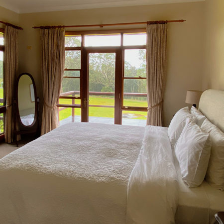 Luxurious master bedroom with king bed, ensuite and private balcony