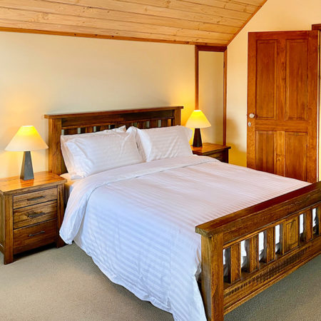 The other one of upstairs bedrooms with a queen bed and two single beds